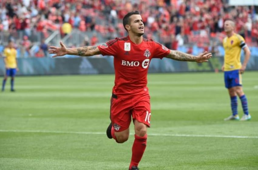 Sep 19, 2015; Toronto, Ontario, CAN; Toronto FC forward Sebastian Giovinco (10) reacts to the crowd after scoring his second goal against Colorado Rapids in the first half at BMO Field. Mandatory Credit: Dan Hamilton-USA TODAY Sports