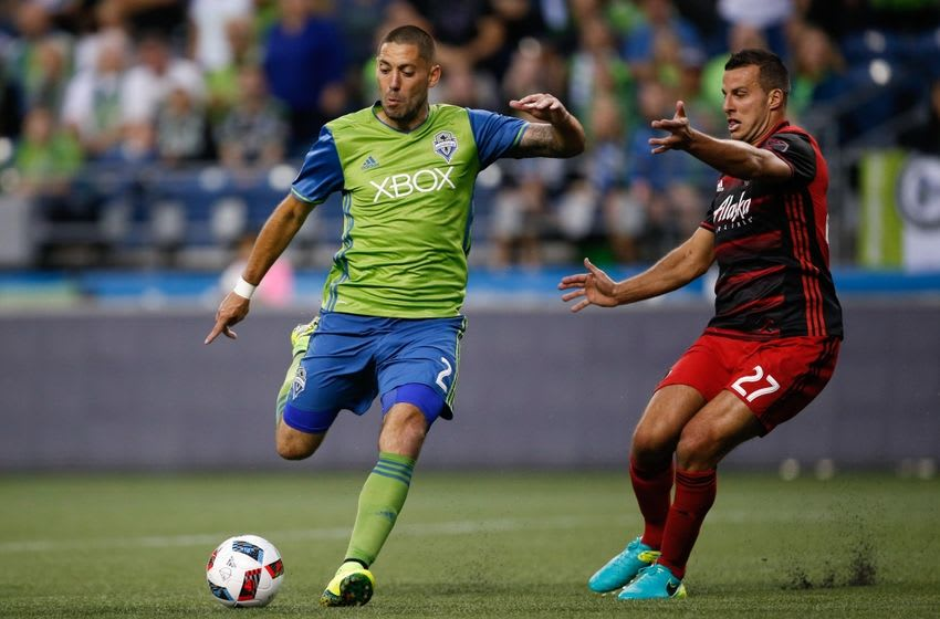 Aug 21, 2016; Seattle, WA, USA; Seattle Sounders FC forward Clint Dempsey (2) dribbles the ball against Portland Timbers defender Steven Taylor (27) during the second half at CenturyLink Field. Mandatory Credit: Jennifer Buchanan-USA TODAY Sports