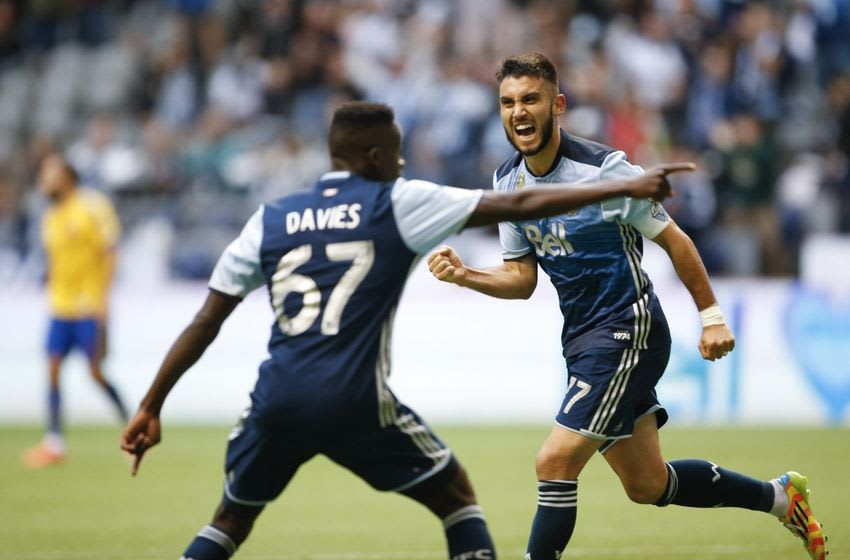 Sep 24, 2016; Vancouver, British Columbia, CAN; Vancouver Whitecaps midfielder Pedro Morales (77) celebrates his goal with forward Alphonso Davies (67) against the Colorado Rapids during the second half at BC Place. Vancouver tied Colorado 3-3. Mandatory Credit: Jennifer Buchanan-USA TODAY Sports