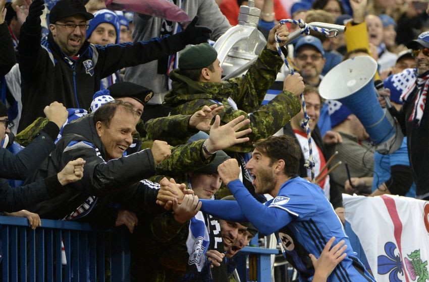 Oct 16, 2016; Montreal, Quebec, CAN; Montreal Impact midfielder Ignacio Piatti (10) reacts with the crowd after scoring a goal against the Toronto FC on a penalty kick during the second half at Stade Saputo. Mandatory Credit: Eric Bolte-USA TODAY Sports