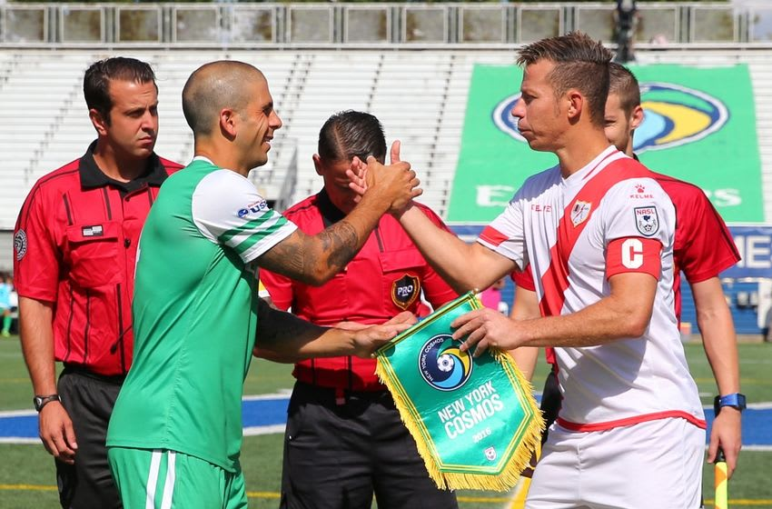 Aug 7, 2016; Hempstead, NY, USA; New York Cosmos and Rayo OKC captains exchange banners before the game at James M. Shuart Stadium. The game was a 1-1 tie. Mandatory Credit: Anthony Gruppuso-USA TODAY Sports
