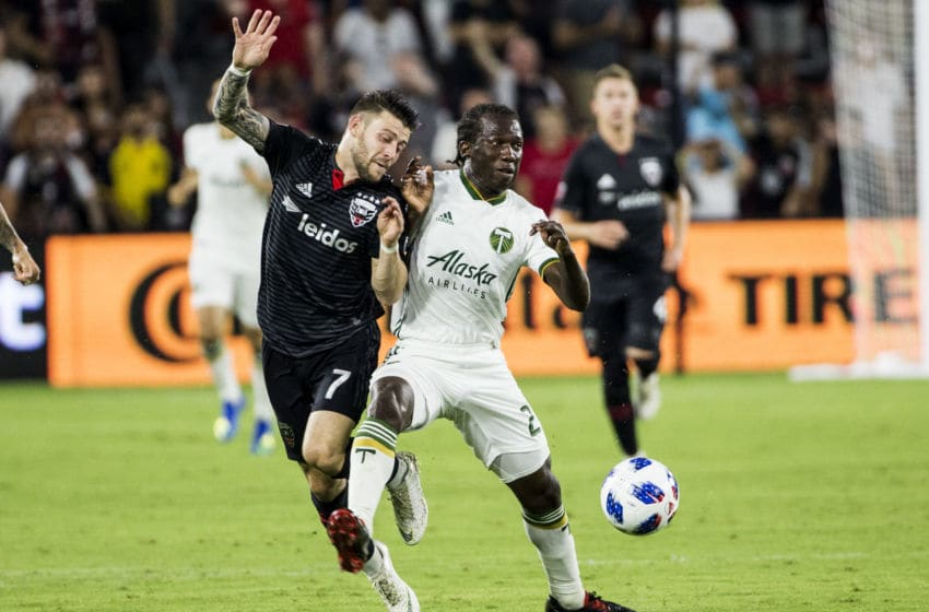 WASHINGTON, DC - AUGUST 15: Portland Timbers midfielder Diego Chara pushes D.C. United forward Paul Arriola (7) off the ball during a MLS match between D.C United and the Portland Timbers, on August 15, 2018, at Audi Field, in Washington, D.C. D.C. United defeated the Portland Timbers 4-1. (Photo by Tony Quinn/Icon Sportswire via Getty Images)