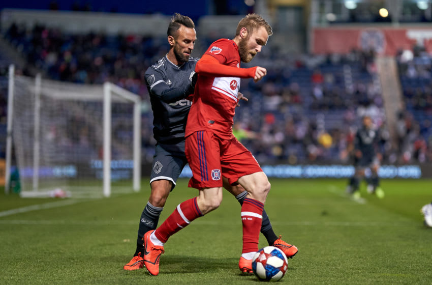 CHICAGO, IL - APRIL 12: Chicago Fire forward Aleksandar Katai (10) battles with Vancouver Whitecaps midfielder Scott Sutter (23) in action during a game between the Chicago Fire and the Vancouver Whitecaps on April 12, 2019 at SeatGeek Stadium in Bridgeview, IL. (Photo by Robin Alam/Icon Sportswire via Getty Images)