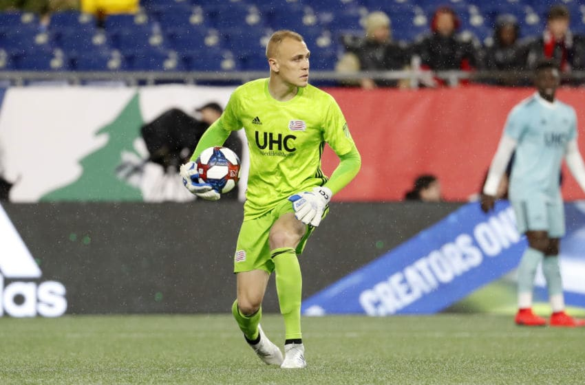 FOXBOROUGH, MA - APRIL 20: New England Revolution goalkeeper Cody Cropper (1) distributes the ball during a match between the New England Revolution and the New York Red Bulls on April 20, 2019, at Gillette Stadium in Foxborough, Massachusetts. (Photo by Fred Kfoury III/Icon Sportswire via Getty Images)