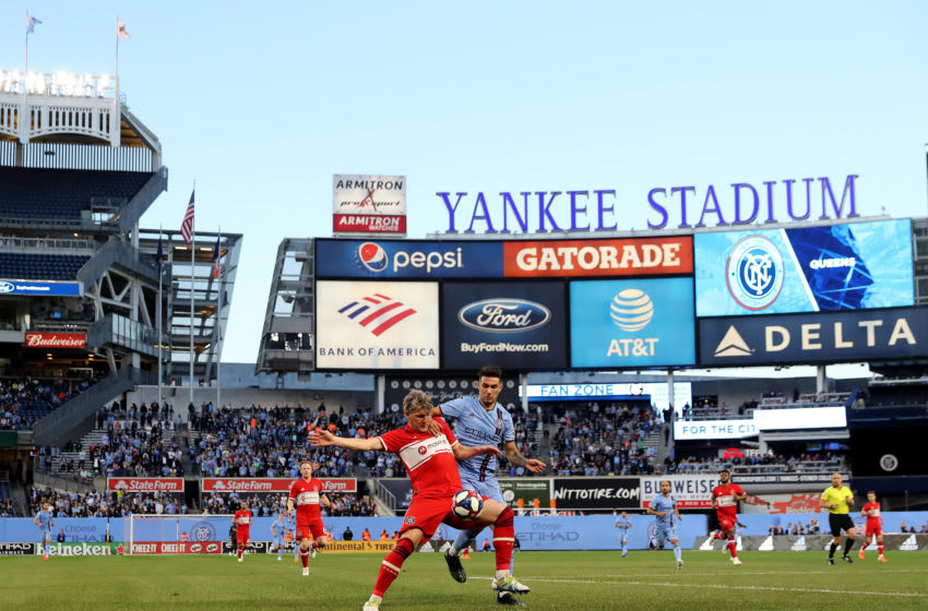 NEW YORK, NEW YORK - APRIL 24: Bastian Schweinsteiger #31 of Chicago Fire and Valentin Castellanos #11 of New York City FC fight for the ball in the first half at Yankee Stadium on April 24, 2019 in the Bronx borough of New York City. (Photo by Elsa/Getty Images)