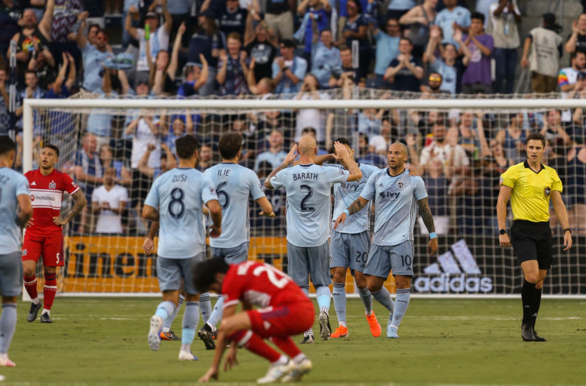 KANSAS CITY, KS - JULY 06: Sporting Kansas City midfielder Yohan Croizet (10) is congratulated by teammates after a goal in the first half of an MLS match between the Chicago Fire and Sporting Kansas City on July 6, 2019 at Children's Mercy Park in Kansas City, KS. (Photo by Scott Winters/Icon Sportswire via Getty Images)