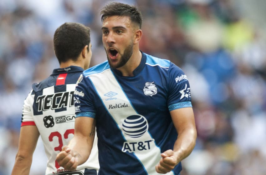 Pueblas Lucas Cavallini celebrates after scoring against Monterrey during a Mexican Apertura 2019 tournament football match at the BBVA Bancomer stadium in Monterrey, Mexico, on September 21, 2019. (Photo by Julio Cesar AGUILAR / AFP) (Photo credit should read JULIO CESAR AGUILAR/AFP via Getty Images)