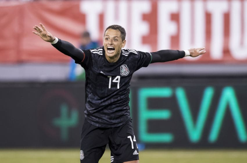 EAST RUTHERFORD, NJ - SEPTEMBER 06: Javier Hernandez #14 of Mexico throws his arms out as he celebrates the goal by Erick Gutierrez #25 of Mexico during the 2nd half of the Friendly match between the United States Men's National Team and Mexico. The match was held at MetLife Stadium on September 06, 2019 in East Rutherford, NJ USA. Mexico won the match with a score of 3 to 0. (Photo by Ira L. Black/Corbis via Getty Images)