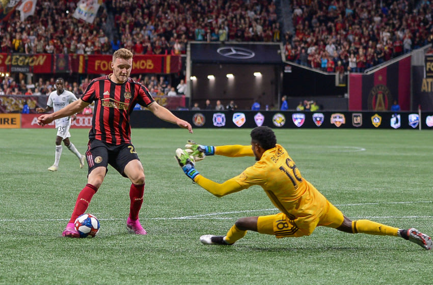 ATLANTA, GA - OCTOBER 24: Atlanta's Julian Gressel (24) shoots over Philadelphia goalkeeper Andre Blake (18) and scores a goal during the MLS playoff match between Philadelphia Union and Atlanta United FC on October 24th, 2019 at Mercedes-Benz Stadium in Atlanta, GA. (Photo by Rich von Biberstein/Icon Sportswire via Getty Images)