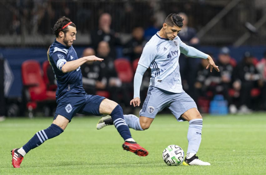 VANCOUVER, BC - FEBRUARY 29: Russell Teibert #31 of the Vancouver Whitecaps challenges Alan Pulido #9 of Sporting Kansas City during MLS soccer action at BC Place on February 29, 2020 in Vancouver, Canada. (Photo by Rich Lam/Getty Images)