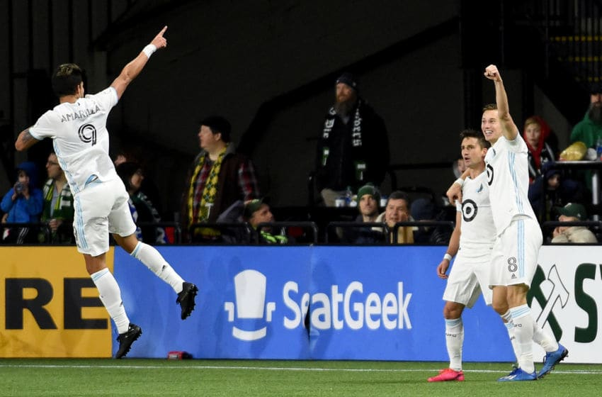 PORTLAND, OREGON - MARCH 01: Angelo Rodriguez #9 of Minnesota United celebrates with Ethan Finlay #13 and Jan Gregus #8 after a goal during the second half against the Portland Timbers at Providence Park on March 01, 2020 in Portland, Oregon. Minnesota won 3-1. (Photo by Steve Dykes/Getty Images)