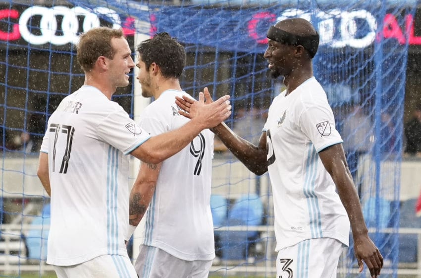 SAN JOSE, CALIFORNIA - MARCH 07: Ike Opara #3 of the Minnesota United FC is congratulated by Chase Gasper #77 after Opara scored a goal against the San Jose Earthquakes during the first half of their MLS Soccer game in the first half at Earthquakes Stadium on March 07, 2020 in San Jose, California. (Photo by Thearon W. Henderson/Getty Images)