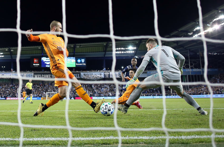 KANSAS CITY, KANSAS - MARCH 07: Goalkeeper Marko Maric #1 and Aljaz Struna #5 of Houston Dynamo let in a goal by Gadi Kinda #17 of Sporting Kansas City during the game at Children's Mercy Park on March 07, 2020 in Kansas City, Kansas. (Photo by Jamie Squire/Getty Images)