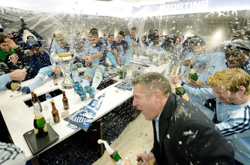 Sporting KC head coach Peter Vermes, right, joins the team in celebrating in the locker room after defeating Real Salt Lake in the MLS Cup Final at Sporting Park in Kansas City, Kan., Saturday, Dec. 7, 2013. Sporting won on penalty kicks. (John Sleezer/Kansas City Star/Tribune News Service via Getty Images)