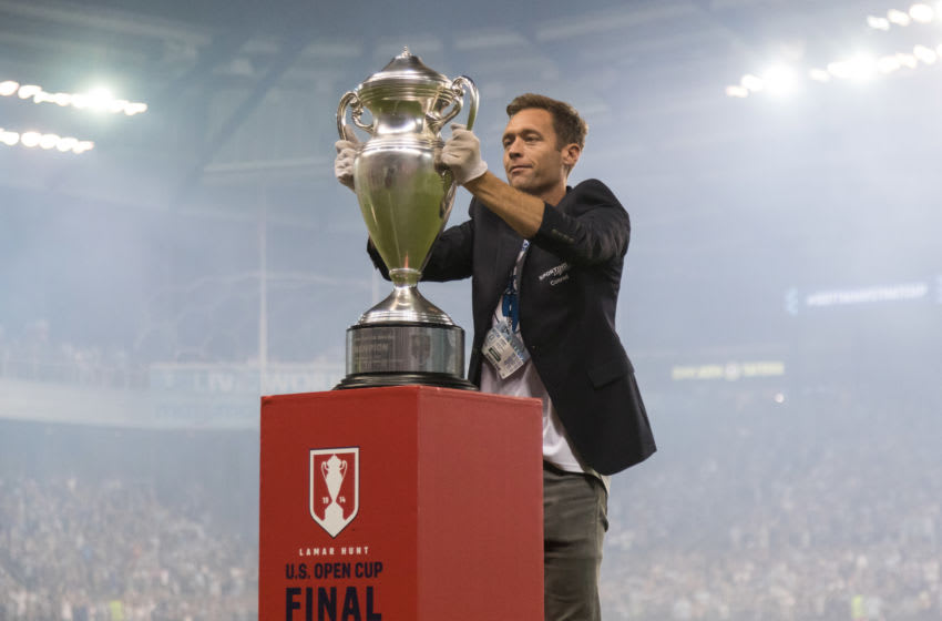 KANSAS CITY, KS - SEPTEMBER 20: Jimmy Conrad carries the US Open Cup to the field prior to the match between Sporting Kansas City and the New York Red Bulls at Children's Mercy Park on September 20, 2017 in Kansas City, Kansas. (Photo by Kevin Sabitus/New York Red Bulls via Getty Images)