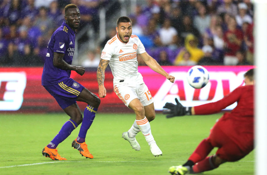 ORLANDO, FL - MAY 13: Hector Villalba #15 of Atlanta United FC attempts a shot on goal past Lamine Sane #22 of Orlando City SC and Joseph Bendik #1 of Orlando City SC during a MLS soccer match at Orlando City Stadium on May 13, 2018 in Orlando, Florida. (Photo by Alex Menendez/Getty Images)