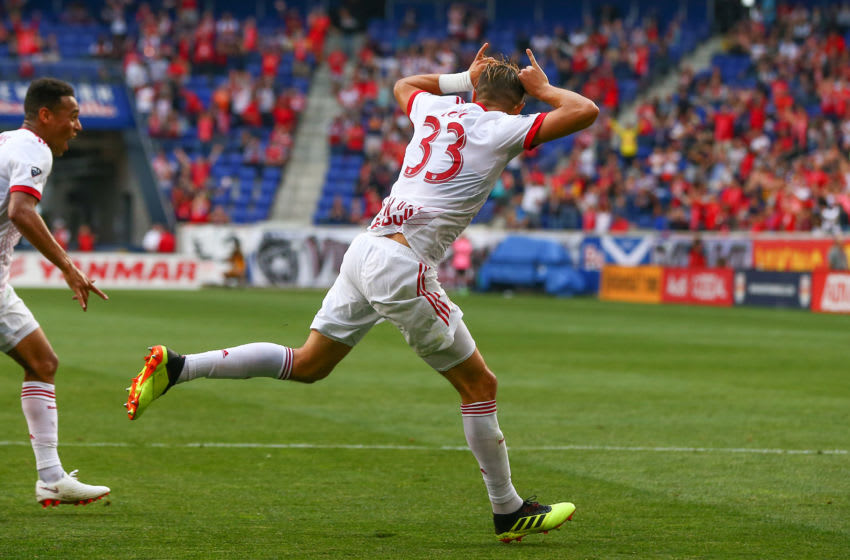 HARRISON, NJ - JUNE 23: New York Red Bulls midfielder Aaron Long (33) celebrates after he scores a goal during the first half of the Major League Soccer game between the New York Red Bulls and FC Dallas on June 23, 2018, at Red Bull Arena in Harrison, NJ. (Photo by Rich Graessle/Icon Sportswire via Getty Images)