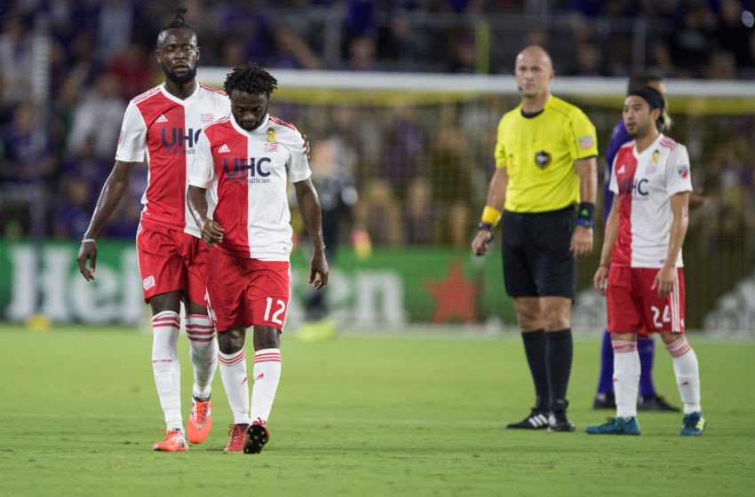 ORLANDO, FL - SEPTEMBER 27: New England Revolution forward Kei Kamara (23) walks with New England Revolution midfielder Laglais Kouassi (12) after he is issued a red card during the MLS soccer match between the Orlando City Lions and the New England Revolution on September 27, 2017 at Orlando City Stadium in Orlando FL. (Photo by Joe Petro/Icon Sportswire via Getty Images)