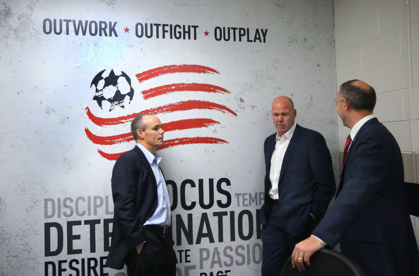 FOXBOROUGH, MA - NOVEMBER 13: Brad Friedel, center, is flanked in the coach's locker room by the Revolution general manager Michael Burns, left, and president Brian Bilello, after he was introduced as the new head coach, at Gillette Stadium in Foxborough, Mass., on Nov. 13, 2017. (Photo by Pat Greenhouse/The Boston Globe via Getty Images)