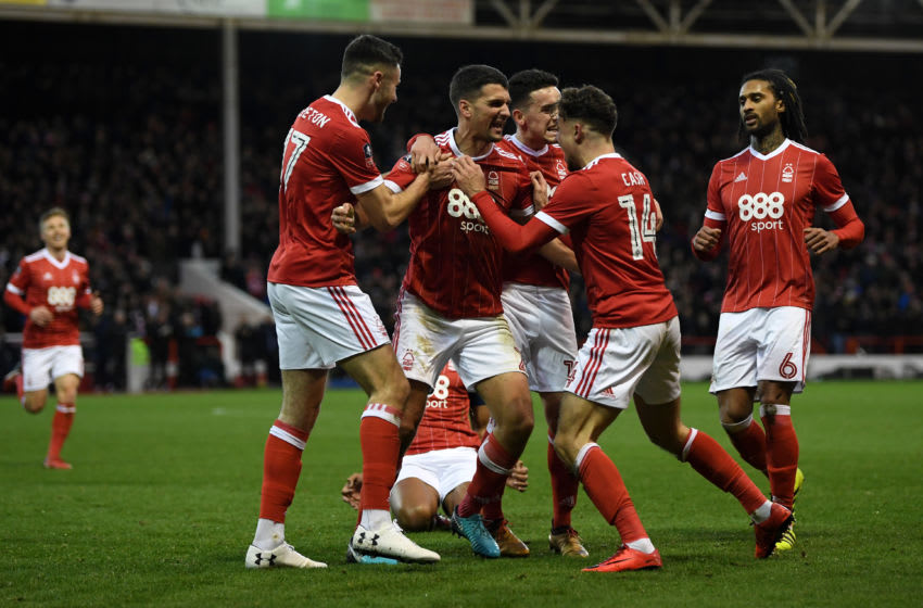 NOTTINGHAM, ENGLAND - JANUARY 07: Eric Lichaj of Nottingham Forest celebrates scoring his side's first goal with team mates during The Emirates FA Cup Third Round match between Nottingham Forest and Arsenal at City Ground on January 7, 2018 in Nottingham, England. (Photo by Shaun Botterill/Getty Images)