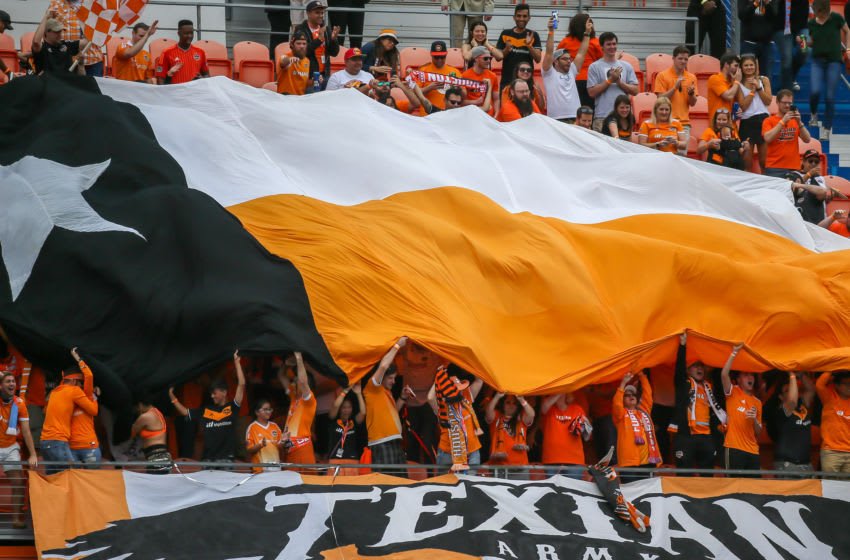HOUSTON, TX - MARCH 03: The Texian Army fan club waves a flag after the Houston Dynamo scores a goal during the opening MLS match between the Atlanta United FC and Houston Dynamo on March 3, 2018 at BBVA Compass Stadium in Houston, Texas. (Photo by Leslie Plaza Johnson/Icon Sportswire via Getty Images)