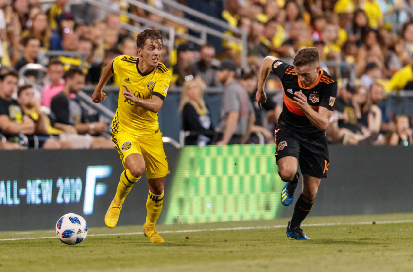 COLUMBUS, OH - AUGUST 11: Columbus Crew forward Pedro Santos (7) blows past Houston Dynamo defender Adam Lundqvist (14)in the MLS regular season game between the Columbus Crew SC and the Houston Dynamo on August 11, 2018 at Mapfre Stadium in Columbus, OH. The Crew won 1-0. (Photo by Adam Lacy/Icon Sportswire via Getty Images)