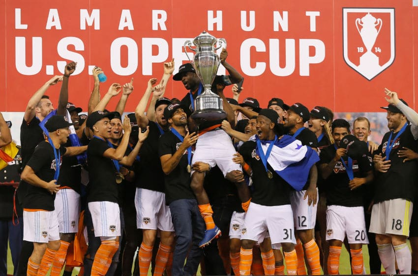 HOUSTON, TX - SEPTEMBER 26: DaMarcus Beasley #7 of Houston Dynamo lifts up the championship trophy after defeating the Philadelphia Union 3-0 during the 2018 Lamar Hunt U.S. Open Cup final at BBVA Compass Stadium on September 26, 2018 in Houston, Texas. (Photo by Bob Levey/Getty Images)