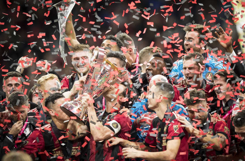 ATLANTA, GA - DECEMBER 08: Michael Parkhurst #3 of Atlanta United team captain kisses Phillip P. Anschutz MLS Championship Trophy in celebration with other teammates after the 2018 Audi MLS Cup Championship match between Atlanta United and the Portland Timbers at the Mercedes Benz Stadium on December 08, 2018 in Atlanta, GA. Atlanta United won the match with a score of 2 to 0. (Photo by Ira L. Black/Corbis via Getty Images)
