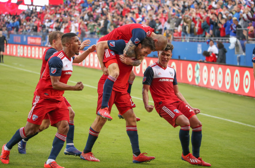 FRISCO, TX - MARCH 23: FC Dallas players celebrate with FC Dallas midfielder Ryan Hollingshead (12) after a goal during the game between FC Dallas and Colorado Rapids on March 23, 2019 at Toyota Stadium in Frisco, TX. (Photo by George Walker/Icon Sportswire via Getty Images)