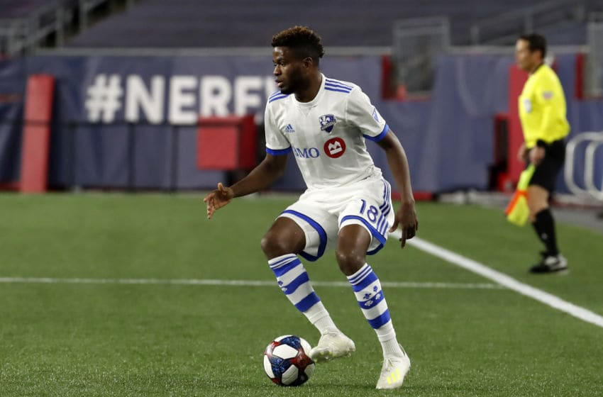 FOXBOROUGH, MA - APRIL 24: Montreal Impact midfielder Orji Okwonkwo (18) cuts with the ball during a match between the New England Revolution and the Montreal Impact on April 24, 2019, at Gillette Stadium in Foxborough, Massachusetts. (Photo by Fred Kfoury III/Icon Sportswire via Getty Images)