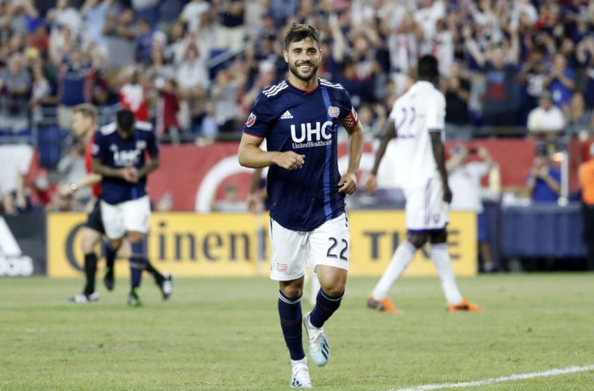FOXBOROUGH, MA - JULY 27: New England Revolution forward Carles Gil (22) Rishes to celebrate his penalty with the substitutes during a match between the New England Revolution and Orlando City SC on July 27 2019, at Gillette Stadium in Foxborough, Massachusetts. (Photo by Fred Kfoury III/Icon Sportswire via Getty Images)