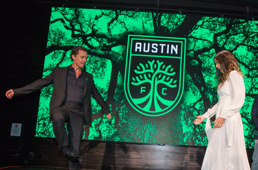AUSTIN, TEXAS - AUGUST 23: Matthew McConaughey and Camila Alves pass a soccer ball back and forth following the Austin FC Major League Soccer club announcement of four new investors including Matthew McConaughey, the 'Minister of Culture' at 3TEN ACL Live on August 23, 2019 in Austin, Texas. (Photo by Rick Kern/Getty Images)