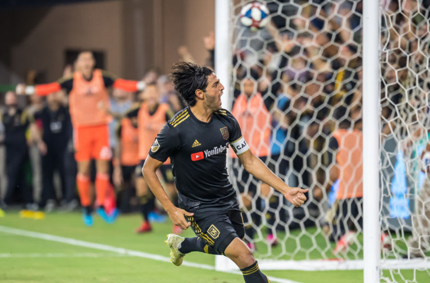 LOS ANGELES, CA - AUGUST 25: Carlos Vela #10 of Los Angeles FC celebrates his goal during Los Angeles FC's MLS match against Los Angeles Galaxy at the Banc of California Stadium on August 25, 2019 in Los Angeles, California. The match ended in a 3-3 draw. (Photo by Shaun Clark/Getty Images)