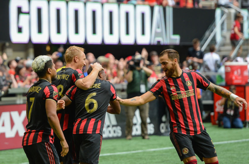 ATLANTA, GA OCTOBER 06: Atlanta's Leandro González Pirez (5) congratulates Darlington Nagbe (6) after Nagbe scored a first-half goal during the MLS match between the New England Revolution and Atlanta United FC on October 6th, 2019 at Mercedes-Benz Stadium in Atlanta, GA. (Photo by Rich von Biberstein/Icon Sportswire via Getty Images)
