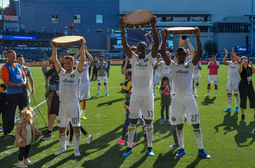 PORTLAND, OR - OCTOBER 06: Portland Timbers players, Sebastián Blanco (10), Larrys Mabiala (33), and Dairon Asprilla (27), lift their slab trophies during the MLS match between the San Jose Earthquakes and the Portland Timbers on October 06, 2019, at Providence Park in Portland, OR. (Photo by Diego Diaz/Icon Sportswire via Getty Images).