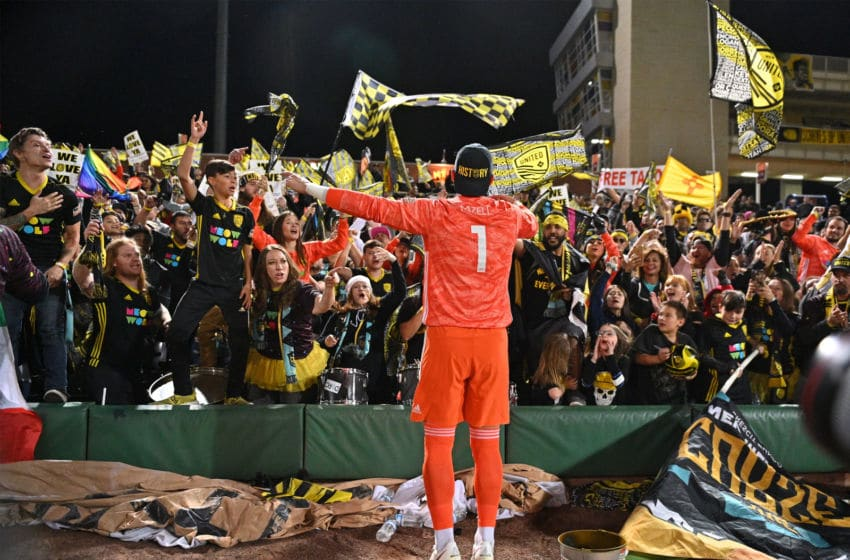 ALBUQUERQUE, NEW MEXICO - OCTOBER 19: Cody Mizell #1 of New Mexico United celebrates with supporters 'The Curse' after the team clinched a playoff spot in their inaugural season after defeating Las Vegas Lights FC 2-0 at Isotopes Stadium on October 19, 2019 in Albuquerque, New Mexico. (Photo by Sam Wasson/Getty Images)