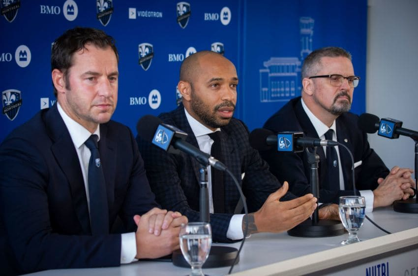 (L-R)Olivier Renard, Sporting Director,Thierry Henry, and Kevin Gilmore, President & Chief Executive Officer speak as The Montreal Impact invites members of the media to meet Thierry Henry, the new head coach at a press conference at the Centre Nutrilait, in Montreal, Quebec, Canada, on November 18, 2019. (Photo by Sebastien ST-JEAN / AFP) (Photo by SEBASTIEN ST-JEAN/AFP via Getty Images)