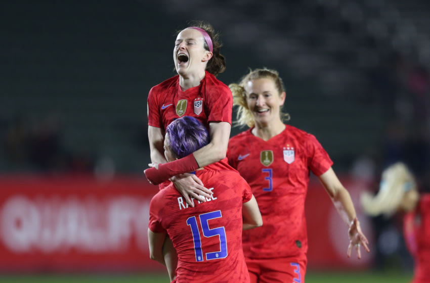 CARSON, CA - FEBRUARY 07: Rose Lavelle #16 of USA celebrates with her teammate Megan Rapinoe #15 after scoring her team's first goal during the semifinals game between Mexico and United States as part of the 2020 CONCACAF Women's Olympic Qualifying at Dignity Health Sports Park on February 7, 2020 in Carson, California. (Photo by Omar Vega/Getty Images)