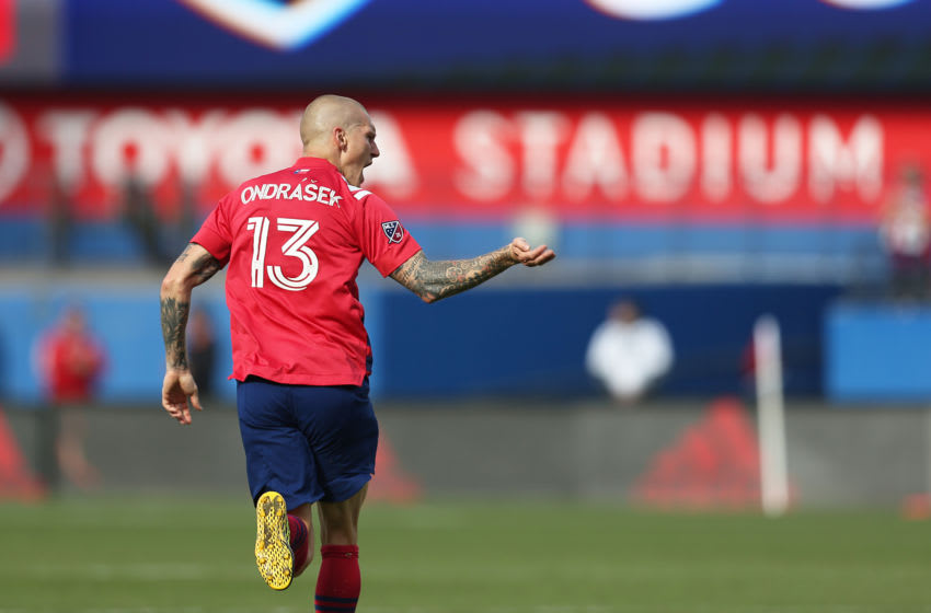 TEXAS CITY, TX - MARCH 07: Zdenek Ondrasek #13 of FC Dallas celebrates the 1st goal for his team during an MLS match between FC Dallas and Montreal Impact at Toyota Stadium on March 7, 2020 in Texas City, Texas. (Photo by Omar Vega/Getty Images)