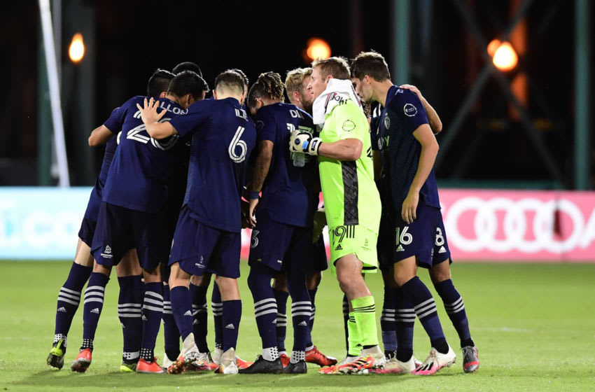 REUNION, FLORIDA - JULY 30: Sporting Kansas City huddles prior to the second half during a quarterfinals match against Philadelphia Union during the MLS Is Back Tournament at ESPN Wide World of Sports Complex on July 30, 2020 in Reunion, Florida. (Photo by Emilee Chinn/Getty Images)