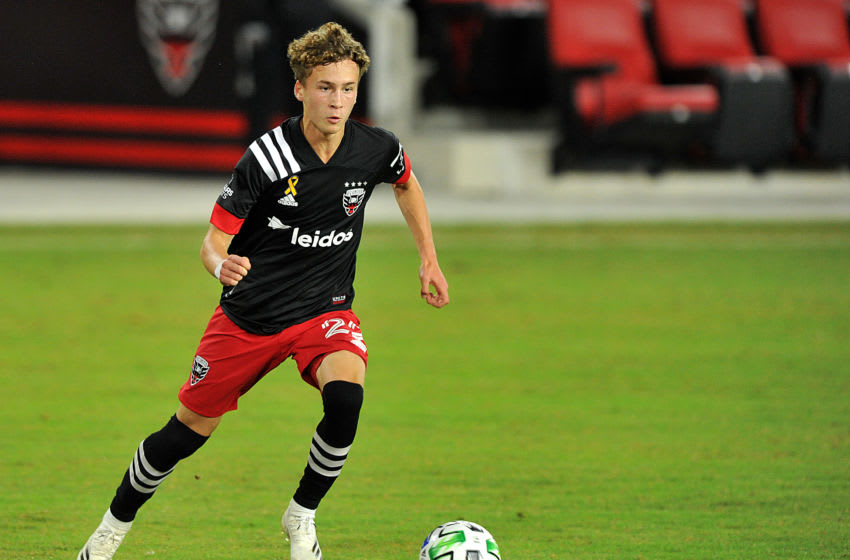 WASHINGTON, DC - SEPTEMBER 27: Griffin Yow #22 of D.C. United moves the ball during a game between New England Revolution and D.C. United at Audi Field on September 27, 2020 in Washington, DC.(Photo by Jose L. Argueta/ISI Photos/Getty Images).