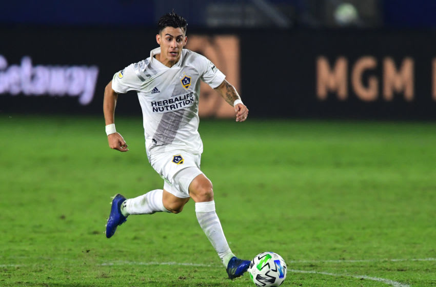 CARSON, CA - NOVEMBER 04: Cristian Pavon #10 of the Los Angeles Galaxy takes the ball down field during the game against the Seattle Sounders at Dignity Health Sports Park on November 4, 2020 in Carson, California. (Photo by Jayne Kamin-Oncea/Getty Images)