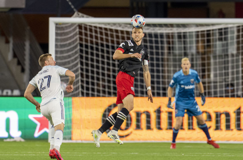 WASHINGTON, DC - MAY 13: Frederic Brillant #13 of D.C. United heads the ball during a game between Chicago Fire FC and D.C. United at Audi FIeld on May 13, 2021 in Washington, DC. (Photo by Brad Smith/ISI Photos/Getty Images)