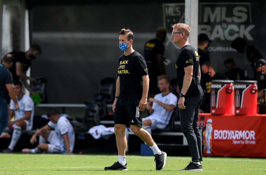 REUNION, FLORIDA - JULY 09: Jim Curtain (right) head coach of Philadelphia Union and Ronny Delia (left) walk on the field after New York City FC was defeated by Philadelphia Union by a score of 1-0 in the MLS is Back Tournament at ESPN Wide World of Sports Complex on July 09, 2020 in Reunion, Florida. (Photo by Douglas P. DeFelice/Getty Images)