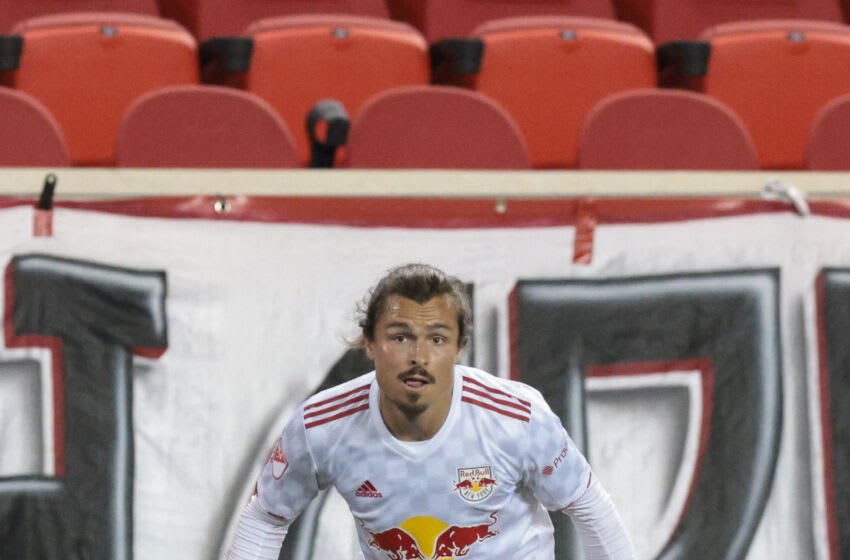 New York Red Bulls midfielder Florian Valot (22) in action during the second half against the Sporting Kansas City at Red Bull Arena. Mandatory Credit: Vincent Carchietta-USA TODAY Sports