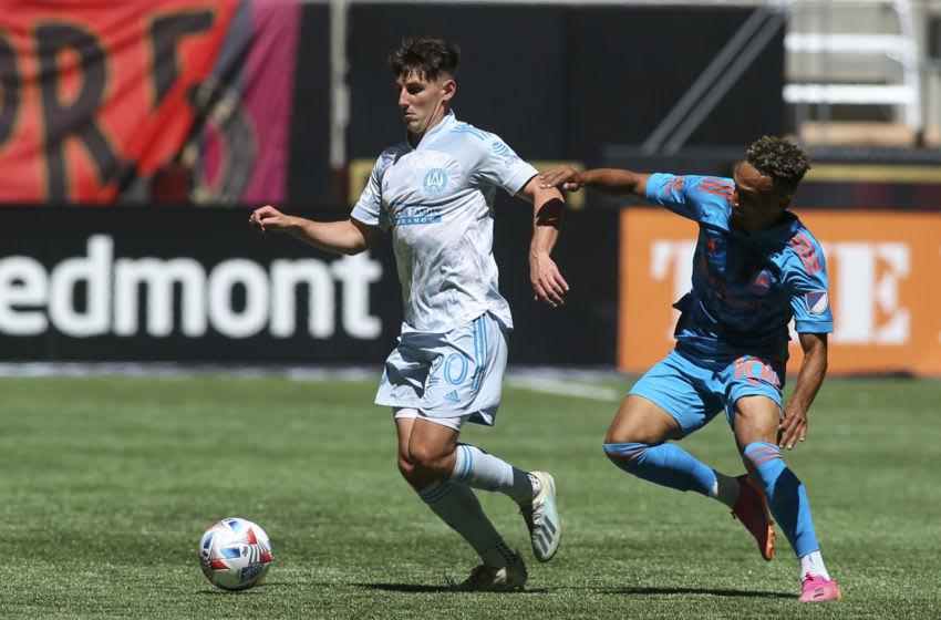 Atlanta United midfielder Emerson Hyndman (20) is defended by Nashville SC midfielder Hany Mukhtar (10) in the first half at Mercedes-Benz Stadium. Mandatory Credit: Brett Davis-USA TODAY Sports