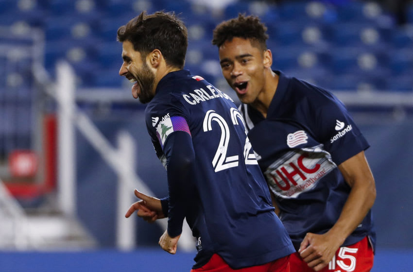 May 1, 2021; Foxborough, Massachusetts, USA; New England Revolution midfielder Carles Gil (22) celebrates with midfielder Brandon Bye (15) after scoring on a penalty during the second half against the Atlanta United at Gillette Stadium. Mandatory Credit: Winslow Townson-USA TODAY Sports