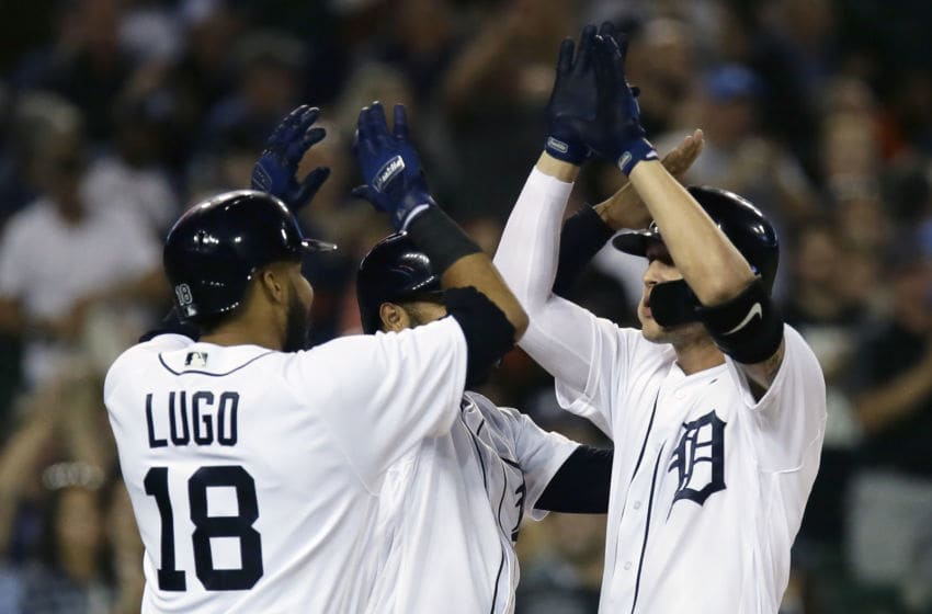 DETROIT, MI - SEPTEMBER 11: JaCoby Jones #21 of the Detroit Tigers celebrates with Dawel Lugo #18 and Ronny Rodriguez #60 after hitting a three-run home run against the Houston Astros during the fourth inning at Comerica Park on September 11, 2018 in Detroit, Michigan. (Photo by Duane Burleson/Getty Images)
