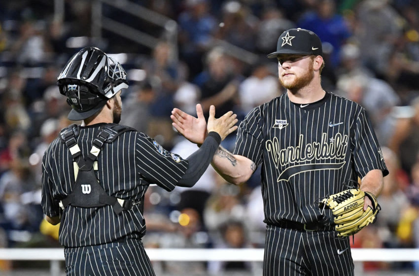 OMAHA, NE - JUNE 25: Pitcher Tyler Brown #21 of the Vanderbilt Commodores celebrates with Pjilip Clarke #5 after beating the Michigan Wolverines during game two of the College World Series Championship Series on June 25, 2019 at TD Ameritrade Park Omaha in Omaha, Nebraska. (Photo by Peter Aiken/Getty Images)