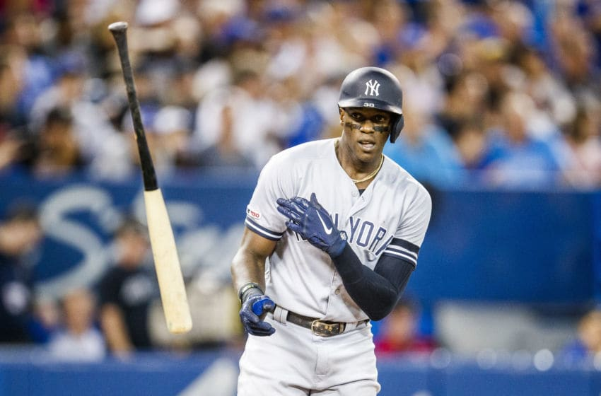 TORONTO, ONTARIO - AUGUST 9: Cameron Maybin #38 of the New York Yankees reacts to striking out against the Toronto Blue Jays in the eighth inning during their MLB game at the Rogers Centre on August 9, 2019 in Toronto, Canada. (Photo by Mark Blinch/Getty Images)